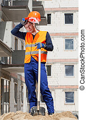 Exhausted construction worker - Vertical view of a exhausted...