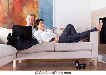 Business couple resting at home - Tired business couple...