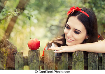 Snow White with Red Apple - Young Snow-White princess with...