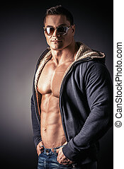 charisma - Portrait of a sexy muscular young man posing over...