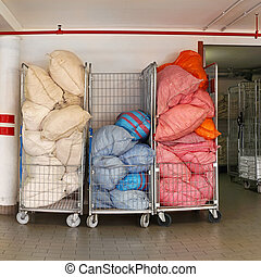 Laundry carts - Bags with dirty sheets at laundry carts