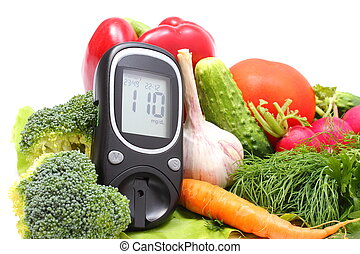 Glucose meter for glucose level and fresh vegetables on...