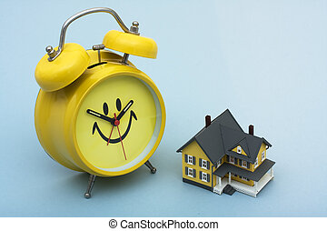 Time to Refinance Your Home - A model home with a clock...