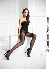 Tights - Beautiful, leggy woman in thin tights and...