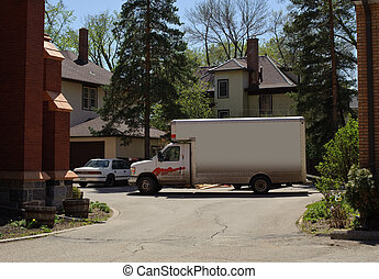 moving truck - A moving truck in front of a house