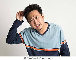 Bad hair day - Asian man with bad hairstyle, on plain...