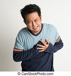 Heartache - Asian male heartache, pressing on chest with...