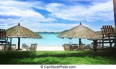 Sun umbrellas and chairs on beach.