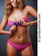 CLose-up photo of a girl in a pink bikini