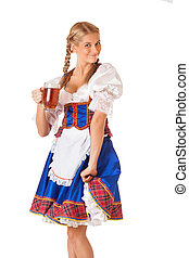 Young sexy Oktoberfest woman wearing a traditional Bavarian...