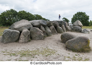 Dolmen in Drenthe - Dolmen with child in the woods of...