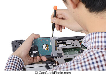 replacing a laptop hard disk drive on a white background