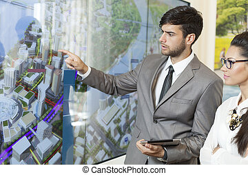 business man holding a presentation - business man with his...