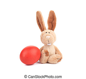 Easter rabbit and colorful egg Isolated on a white...