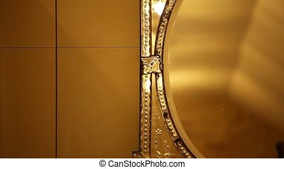 Old antique gold mirror camera in motion