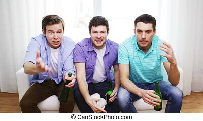 upset male friends with beer watching tv at home -...