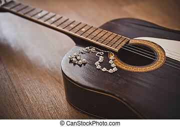 Guitar and ornaments. - Old six-string guitar and ornaments...