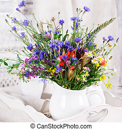 Wildflowers in bottles - Wildflowers in white ceramic jug...
