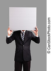 business man holding blank billboard - Young business man...