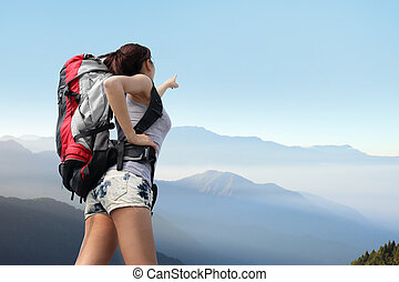 happy woman mountain hiker with backpack look view on the...