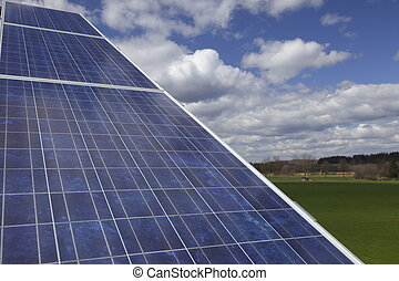 solarpanel - Solar panel against blue cloudy sky in nature