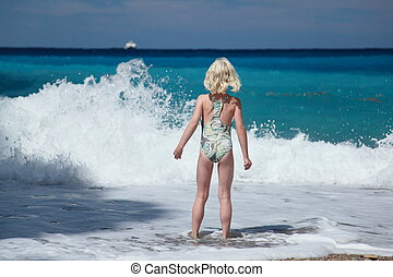 girl and waves - girl is looking to the beautiful big waves