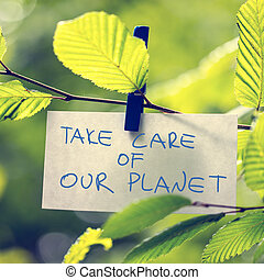 Take Care of our Planet concept with a handwritten note...