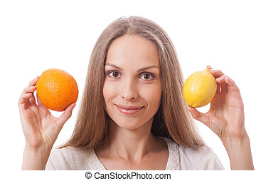 young woman holding orange and lemon - young smiling woman...