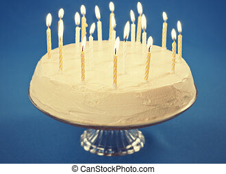 Birthday cake with candles on blue background