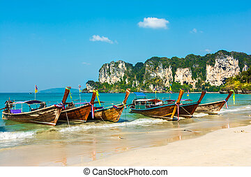 Tropical island paradise on Railey beach - Longtail boats on...