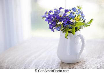 Wildflower bouquet - Bouquet of wild flowers in white vase...
