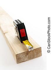 Tape measure on wood - Metal imperial metric tape measure...