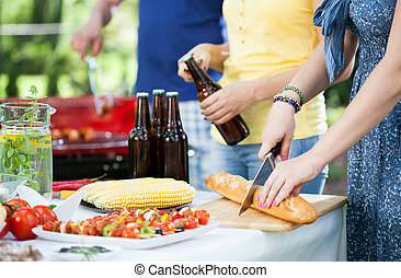 People enjoying barbecue - Young people enjoying good...