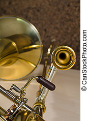Trombone against the background of a cork cladded studio...