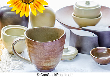 Mug and ceramic bowl on wooden table