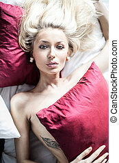 Sexy blonde woman in bed