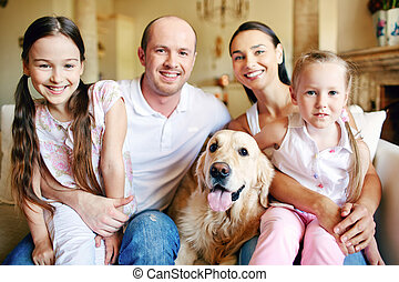 Family with labrador - A young friendly family of four with...