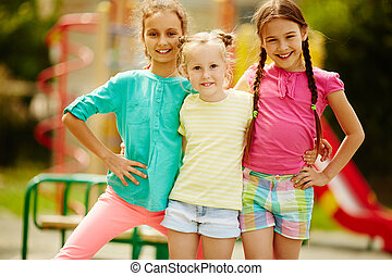 Girls in casual - Image of cute girls posing on playground...