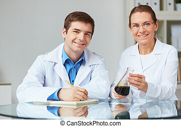 Laboratory observations - Two scientists looking at camera...