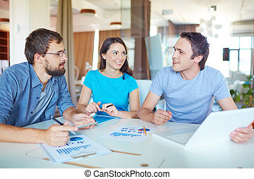 Working in the office - Group of three successful business...