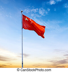 China flag - Chinese national flag with blue sky as...
