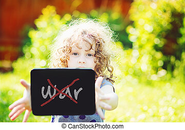 Little girl hold tablet pc, toning photoOn the tablet text...