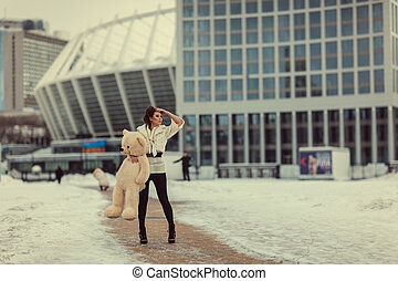 Girl with Baby Bear - Sad beautiful girl standing and...