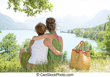 two lesbians in nature admire the landscape - two lesbians...