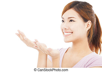 closeup of pretty woman looking the direction of hand gesture
