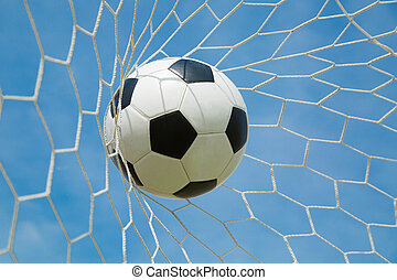 Soccer ball in the goal after shooted in the game