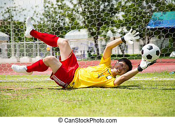 Goalkeeper used hands for catches the ball in match game