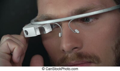 Technology Progress - Macro shot of man focused on smart...