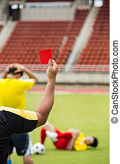Referee soccer show card for warning and recorded player...