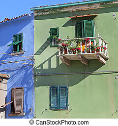 GIGLIO ISLAND, ITALY - JULY 19, 2014:colorful houses in the...